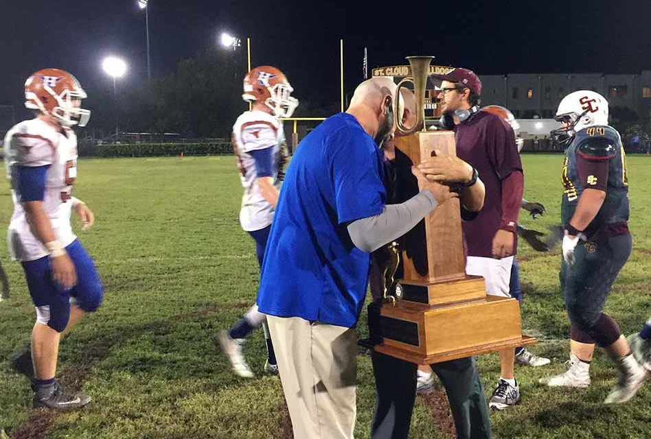 Harmony Longhorns Win Big Over the Bulldogs and Bring Home the Brass Bugle