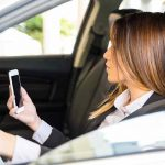 Hand-held phone ban while driving in work and school zones begins Tuesday