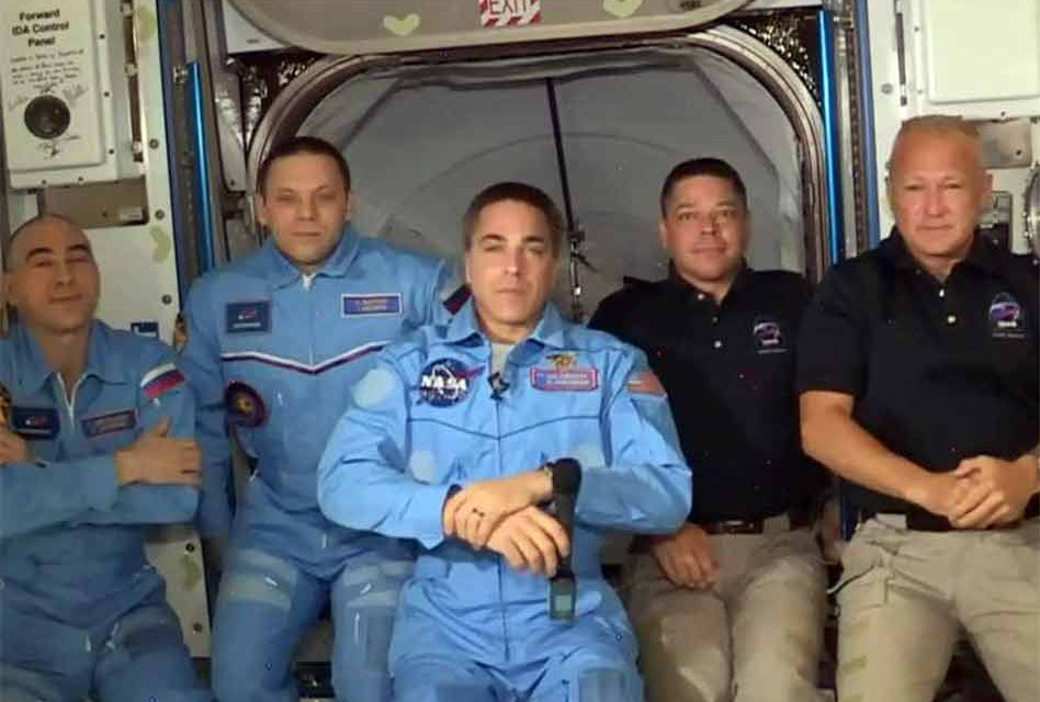 NASA astronauts board the International Space Station after successfully docking the Crew Dragon