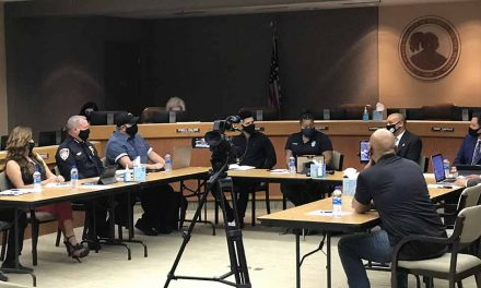 Citizen Advisory Group for School Safety meets at school district to discuss school resource officer policy