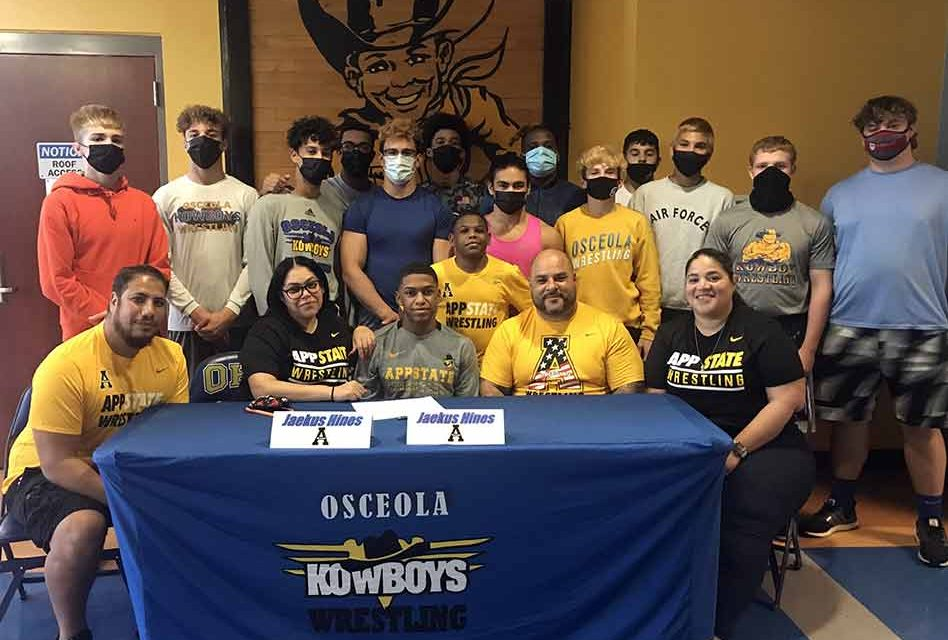 Osceola's Wrestling State Champ Jaekus Hines signs for a scholarship on his way to Appalachian State