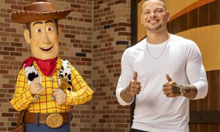 Country singer Kane Brown takes photo with Woody at Disney's Hollywood Studios